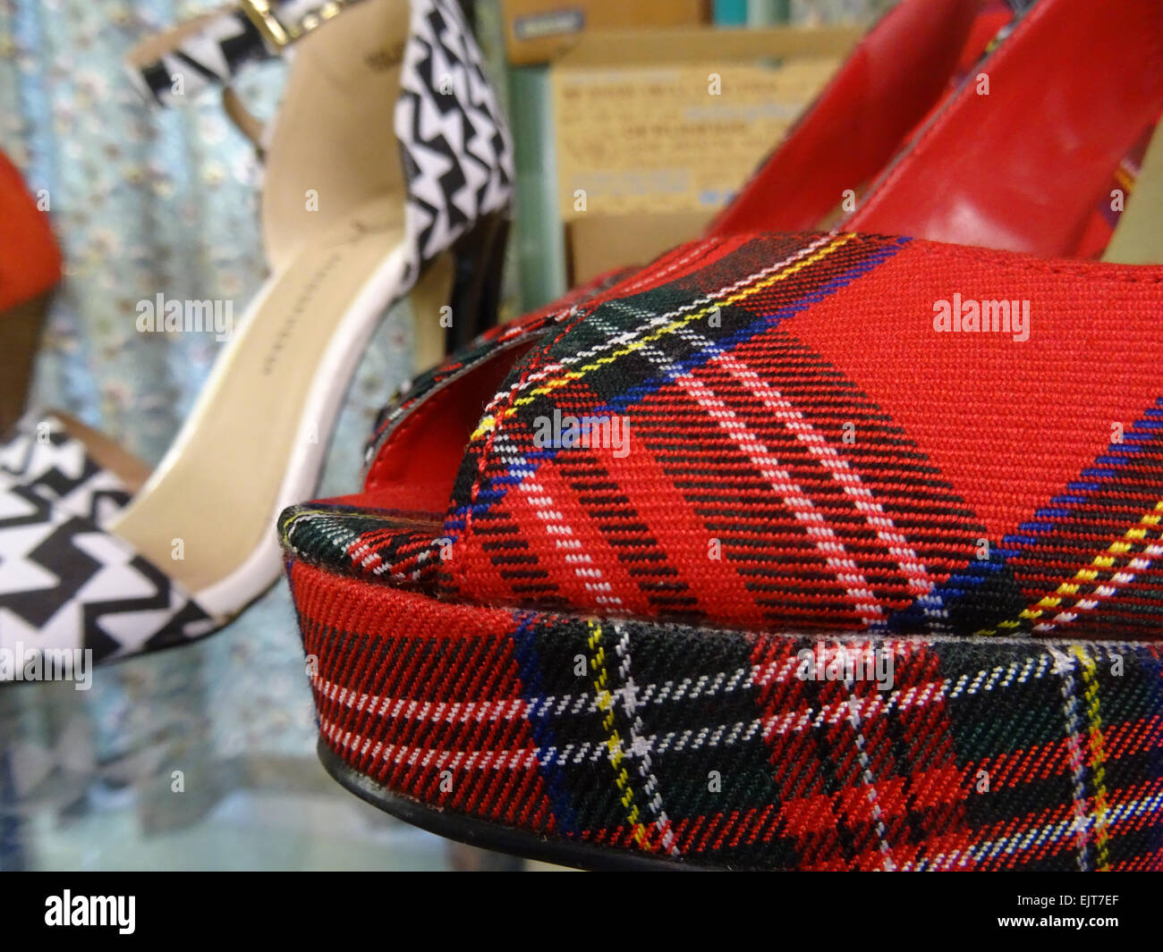 Detail of the toe of a red tartan fabric high heel shoe - Stock Image