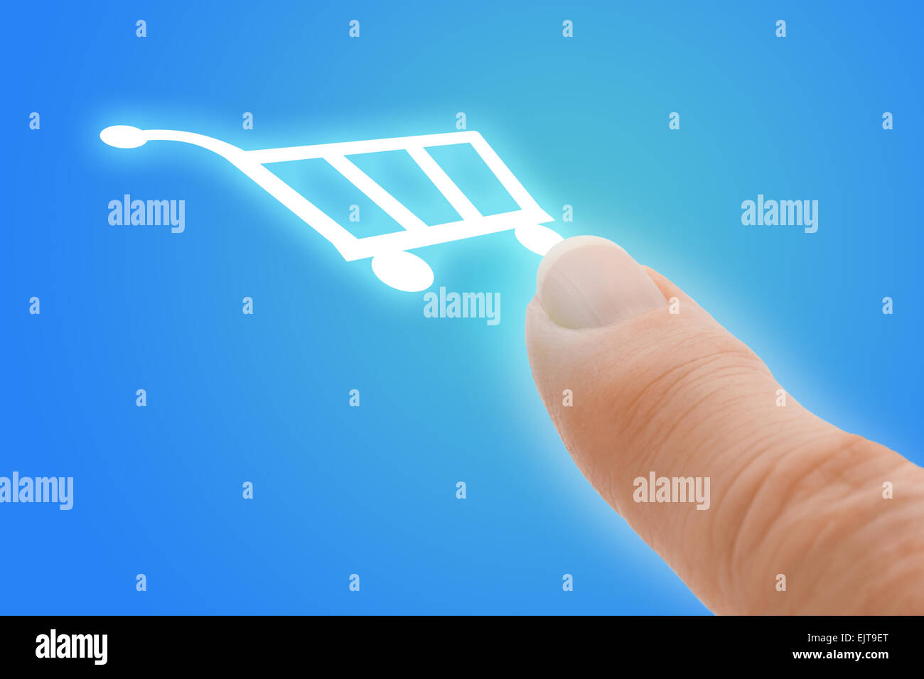 Buy Now Touch Screen Finger Pointing to Shopping Cart Icon - Stock Image
