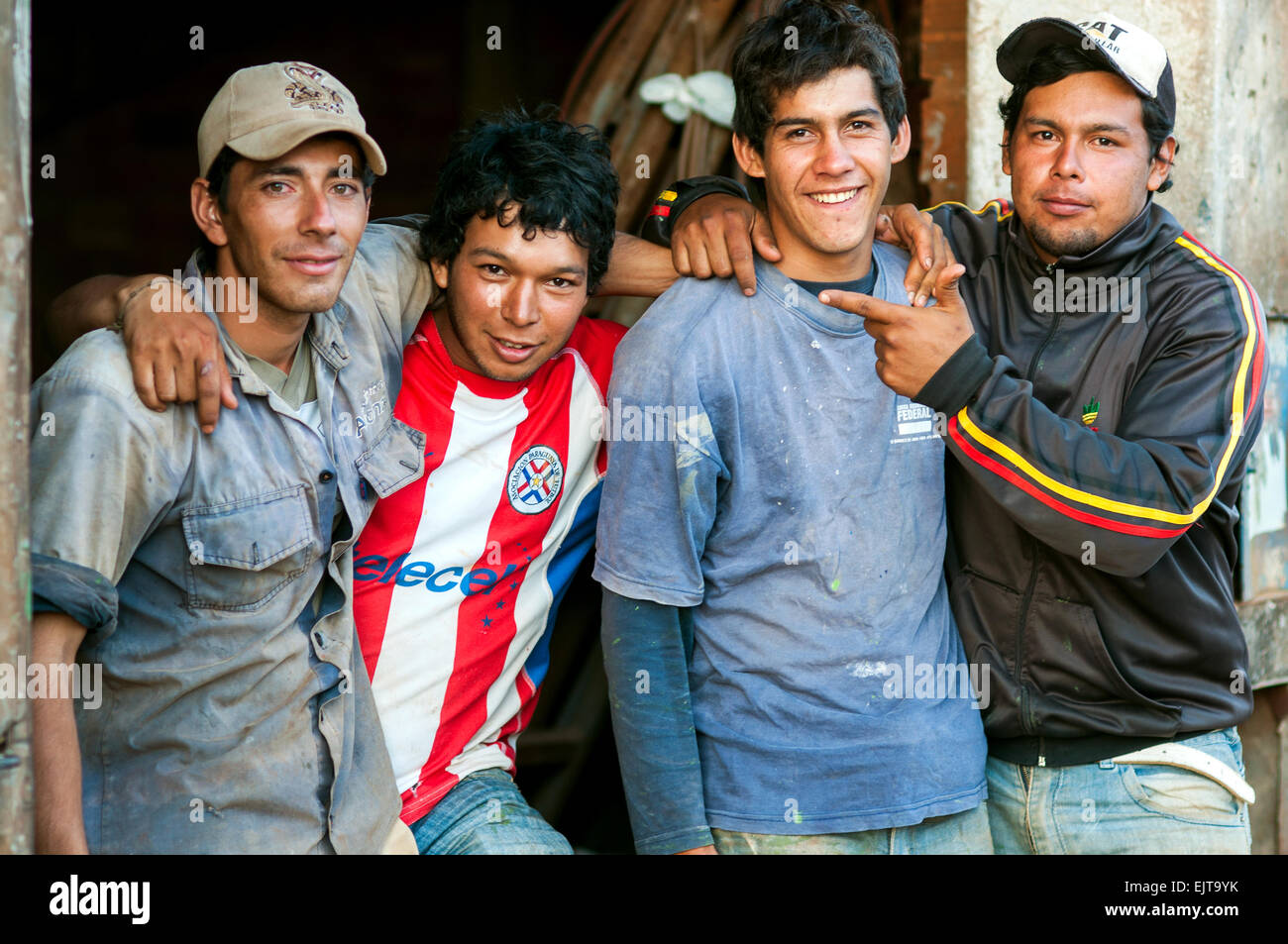 Male factory workers on break, Encarnacion, Paraguay - Stock Image