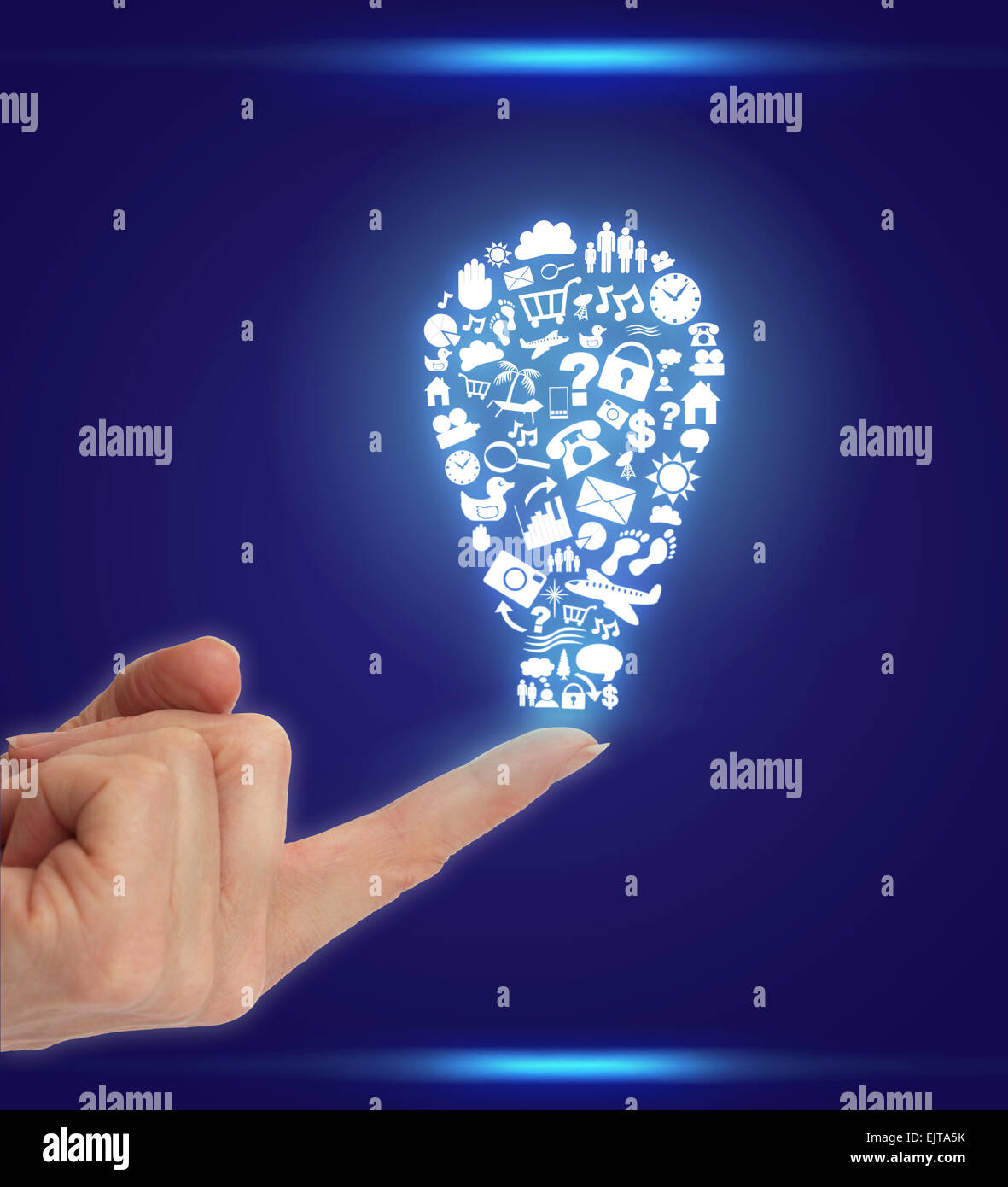 Hand with Icons shaped as Lightbulb - Stock Image