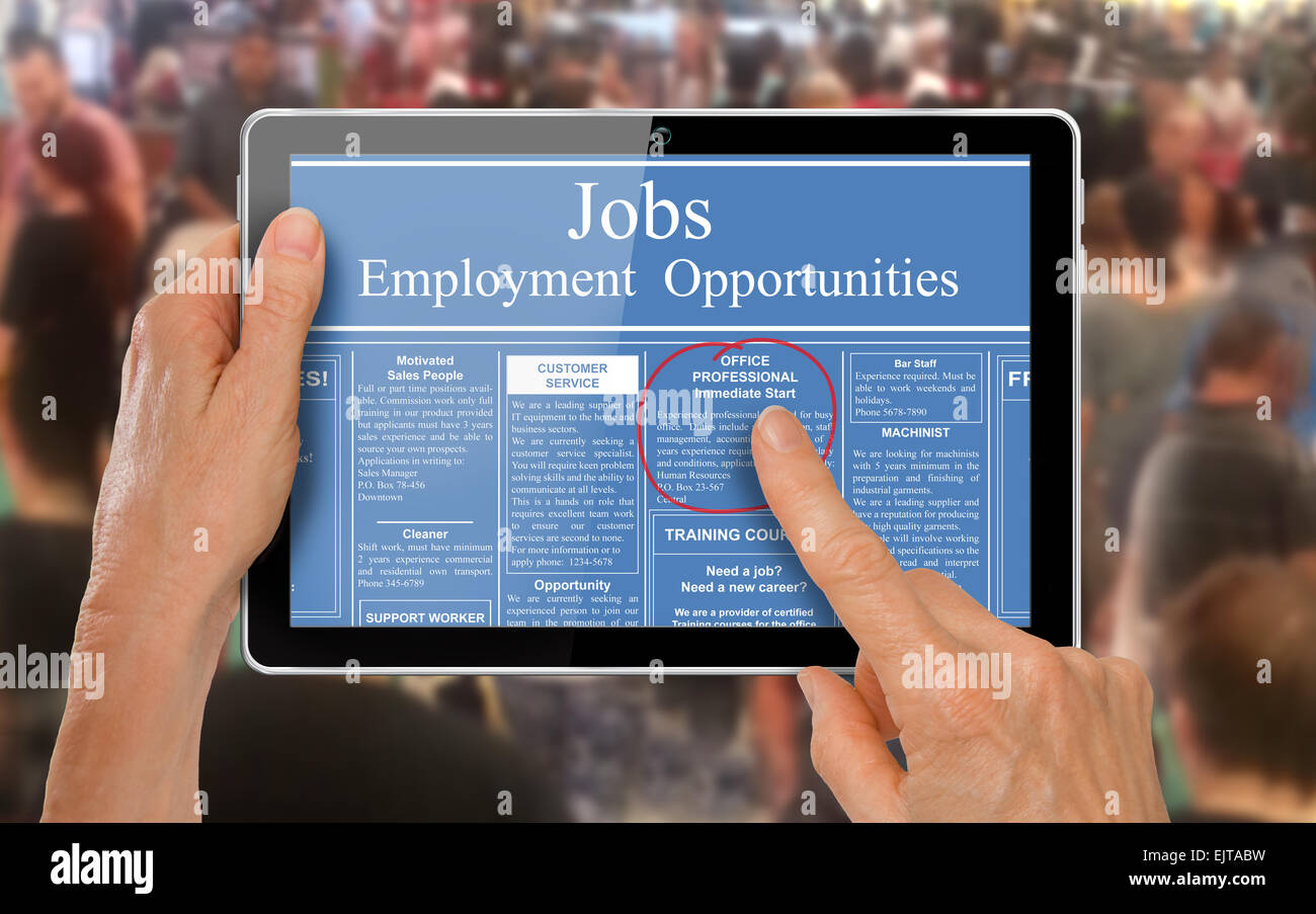 Online job hunting Hands with computer tablet reading employment ads in front of crowd of people - Stock Image