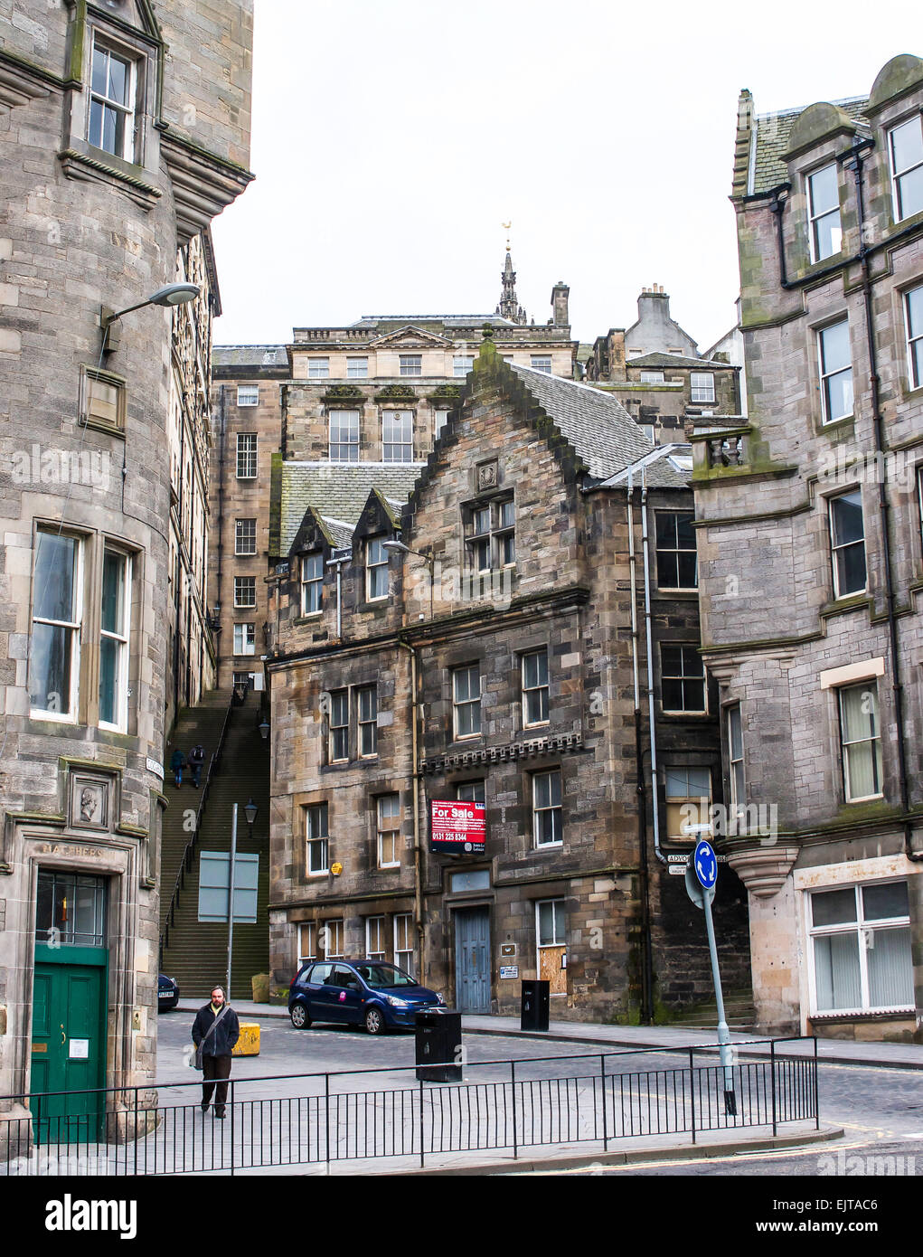 A typical street scene in Edinburgh, Scotland which is full of winding streets and steep stairways to connect the - Stock Image