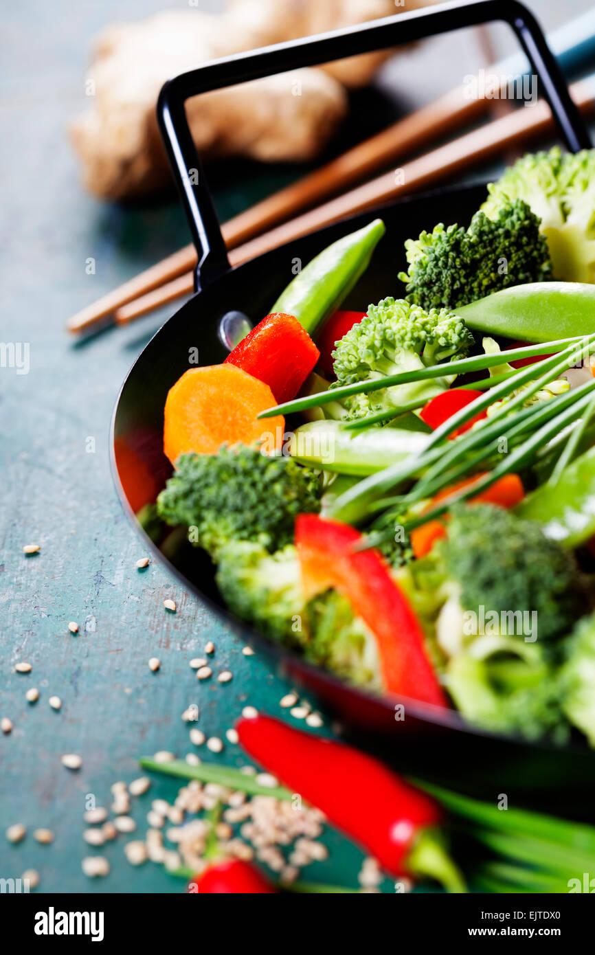 Chinese cuisine. Wok cooking vegetables. Vegetarian wok - Stock Image