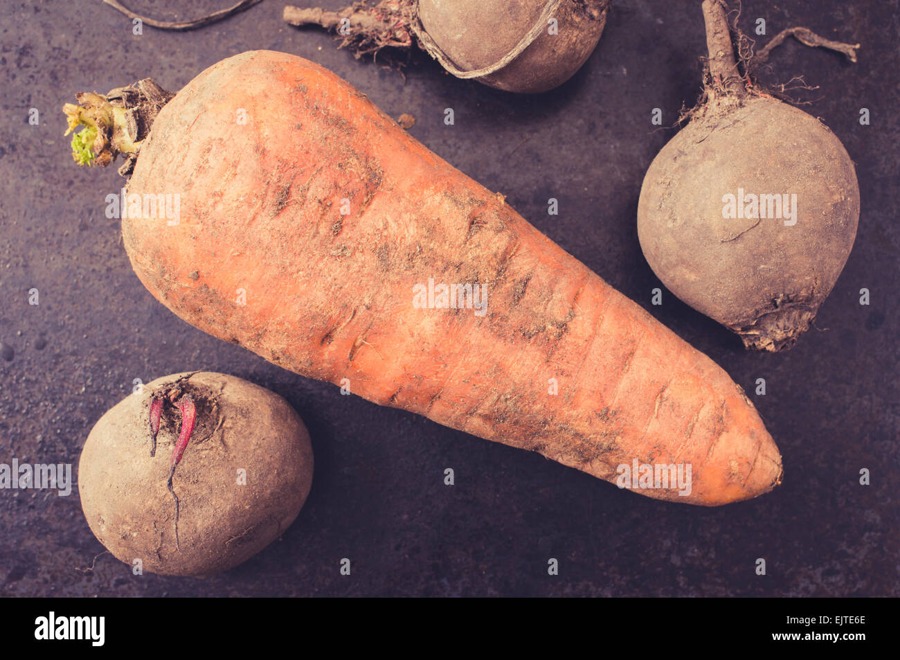 Storing a crop of vegetables carrot and beet top view - Stock Image