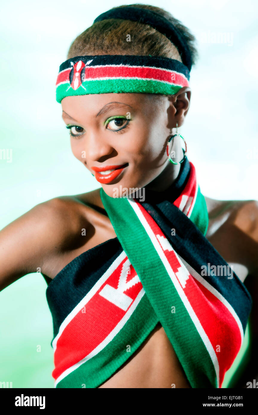 young kenyan woman in national flag colorrs Stock Photo