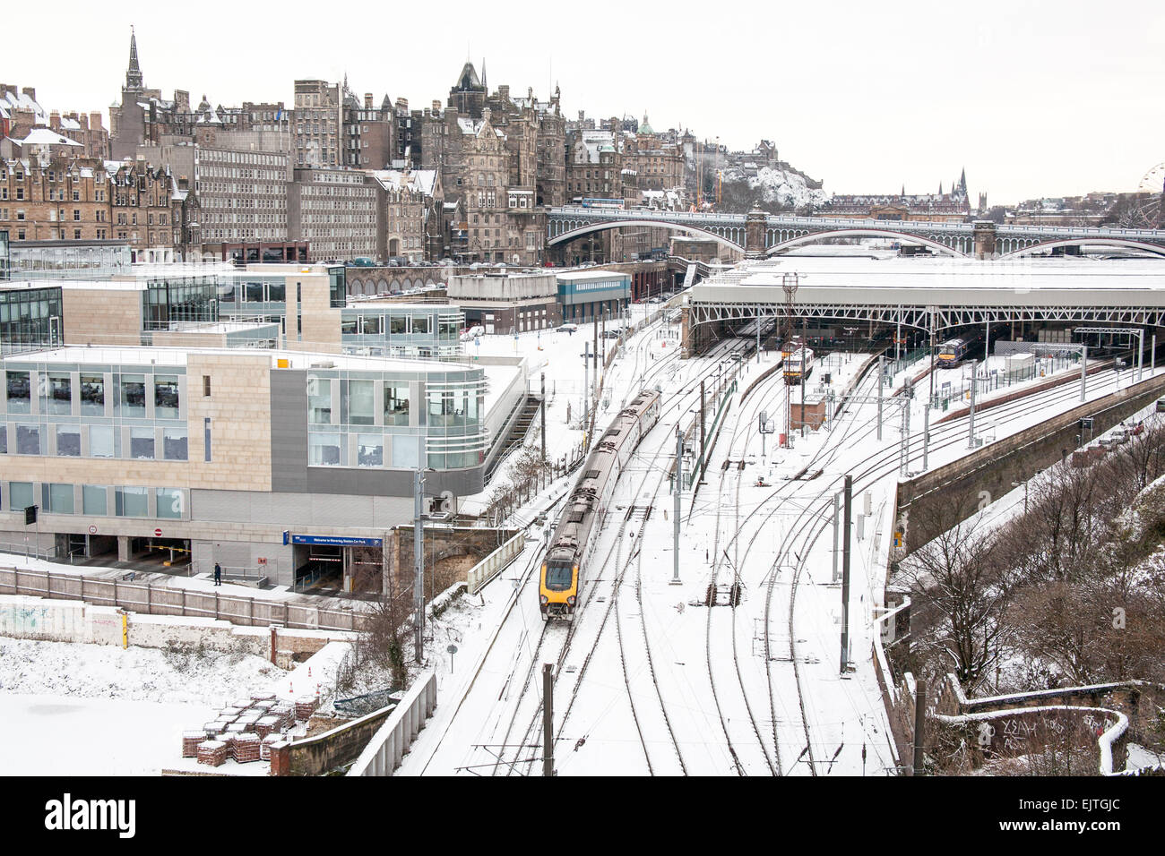 Edinburgh in Winter series with this one looking towards Edinburgh Castle, with Waverley train station in the foreground. - Stock Image