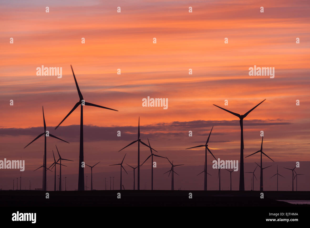 Wind turbines turning at dusk in Eemshaven, Netherlands - Stock Image