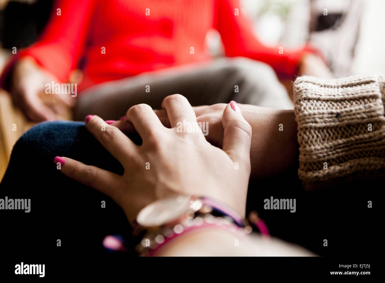 Cropped image of woman with hands clasped - Stock Image