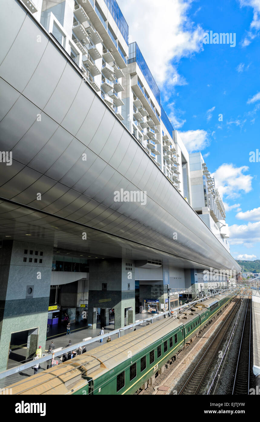 One of Japan's final night (sleeper) trains, waiting to depart from Kyoto Station with its futuristic post-modern - Stock Image