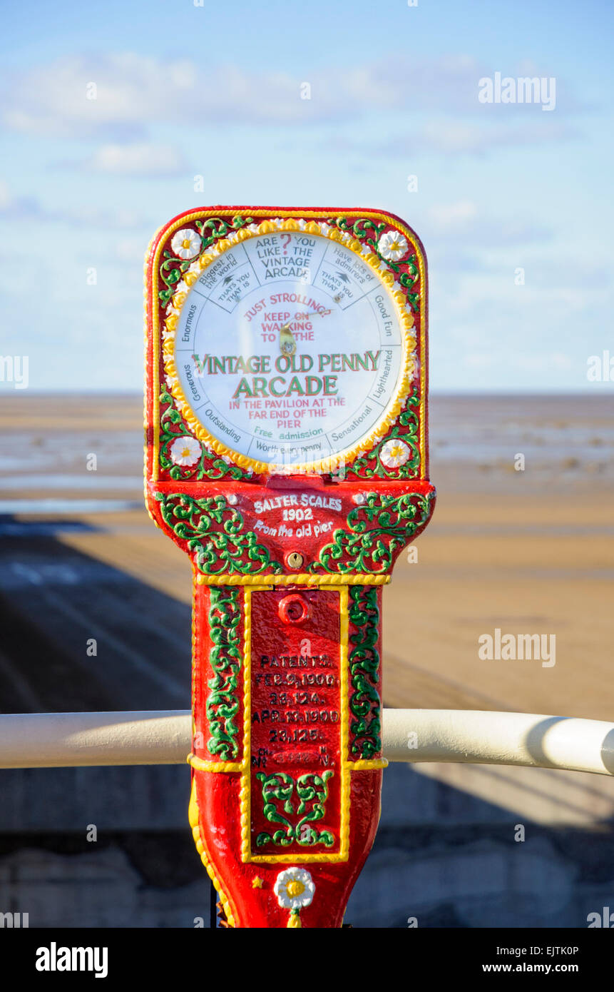Old style humorous scales on an English seaside pier - very typical of Victorian and Edwardian era Britain; amusement; - Stock Image