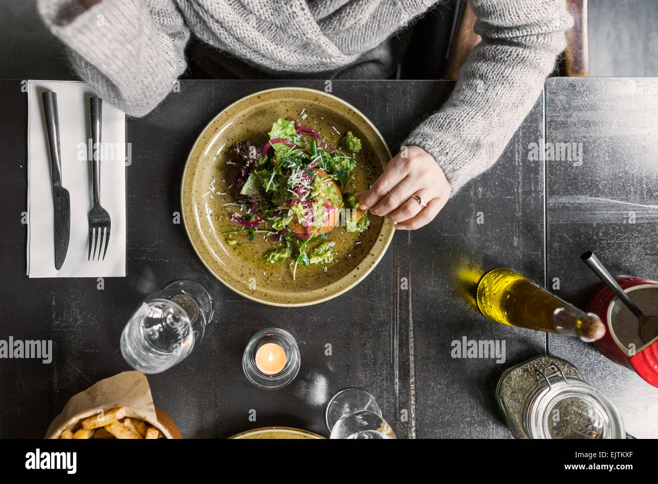 Cropped image of woman with food served on table - Stock Image
