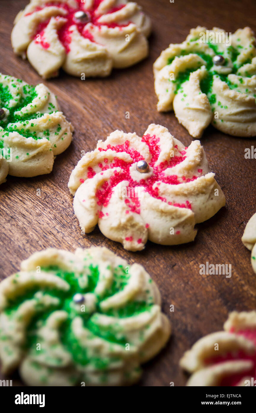 A Close Up of Crown Shaped Cookie Press Holiday Cookies with Colored Sugar Decoration - Stock Image