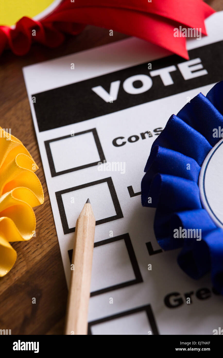 Election Ballot Paper With Rosettes Of Political Parties - Stock Image