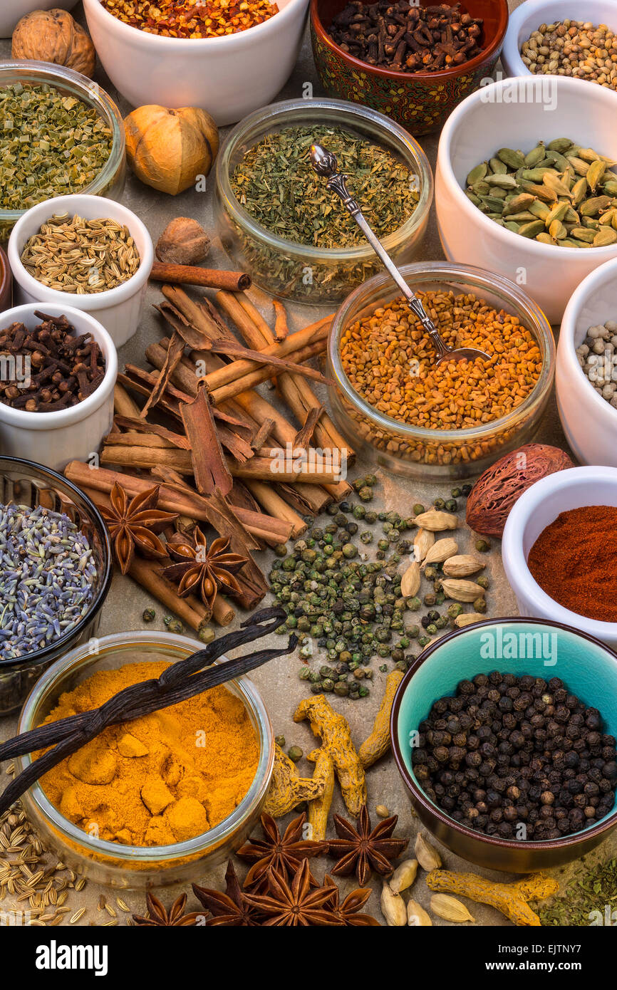A selection of dried herbs and spices. Use in cooking to add seasoning and flavor to a meal. - Stock Image