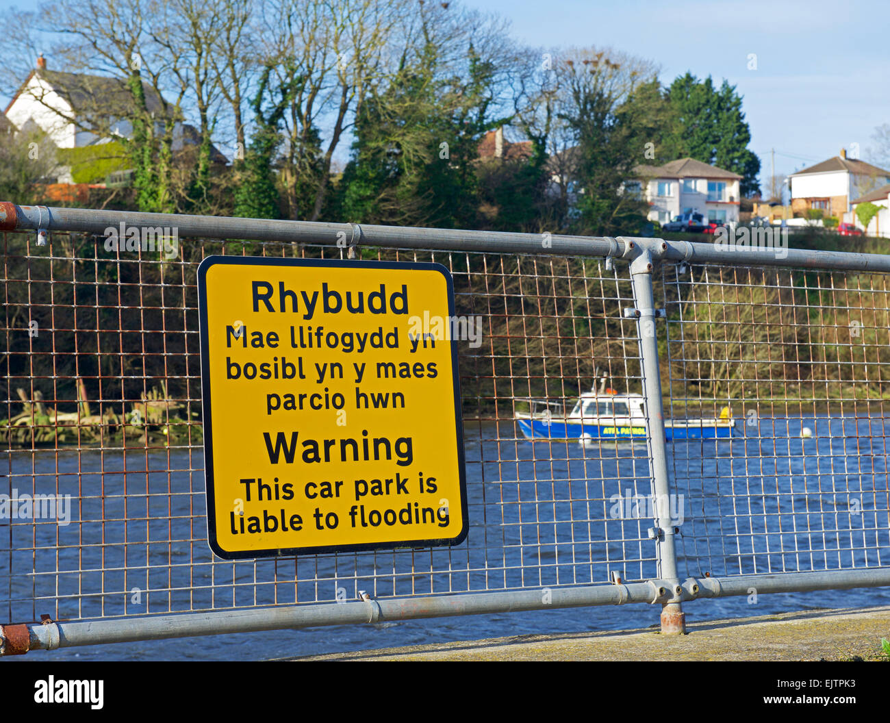 Sign warning that car park is liable to flooding, next to the River Teifi, Cardigan, Ceredigion wales uk Stock Photo