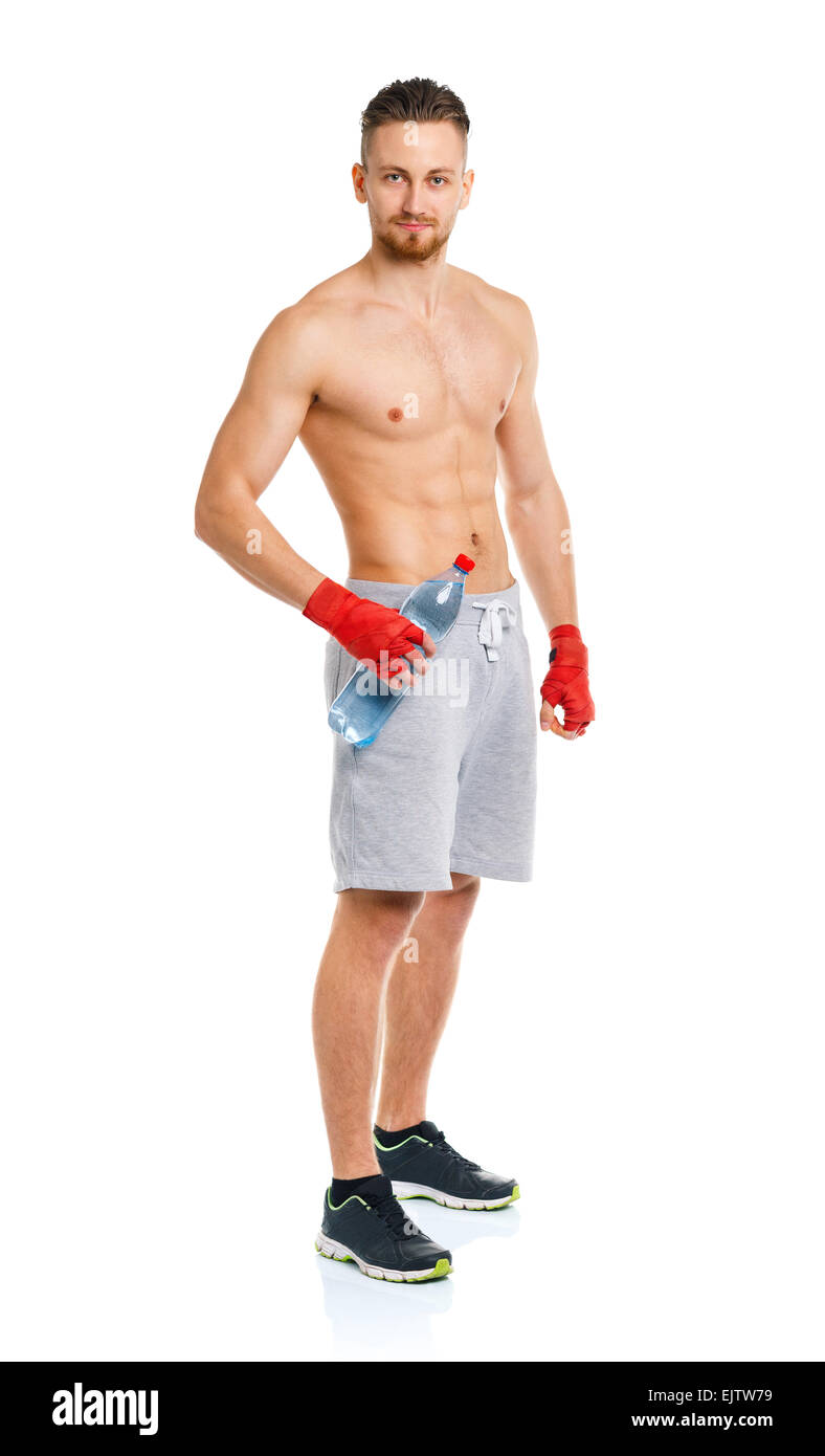Athletic attractive man wearing boxing bandages with bottle of water on the white background - Stock Image