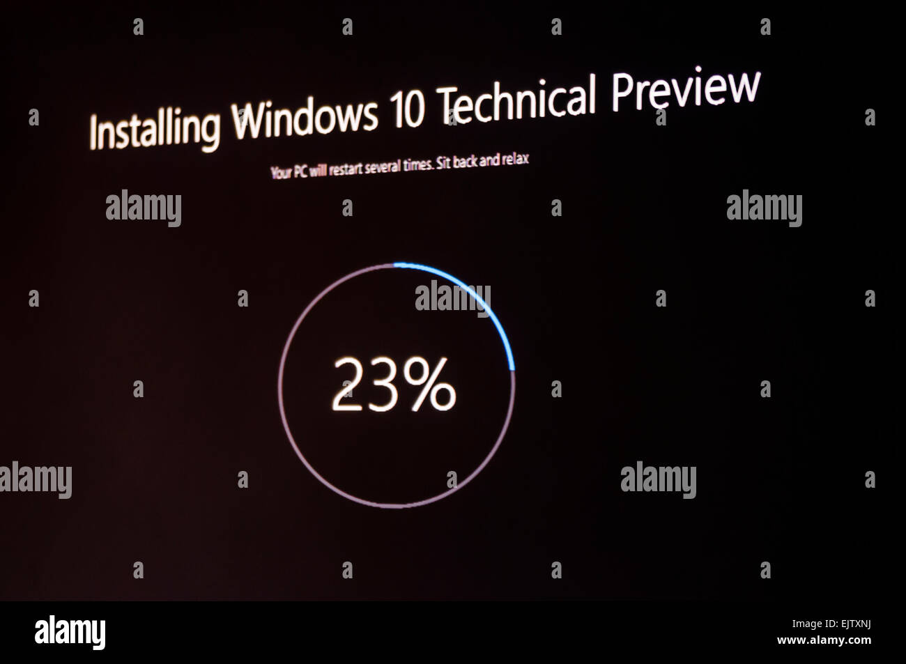 Installing Windows 10 Technical Preview, a public beta release. - Stock Image