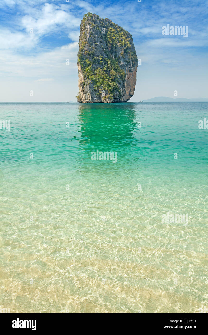 Uninhabited little tropical island, space for text. - Stock Image