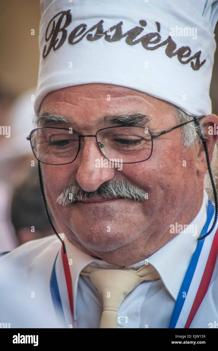 Frenchman with cooks hat on. - Stock Image