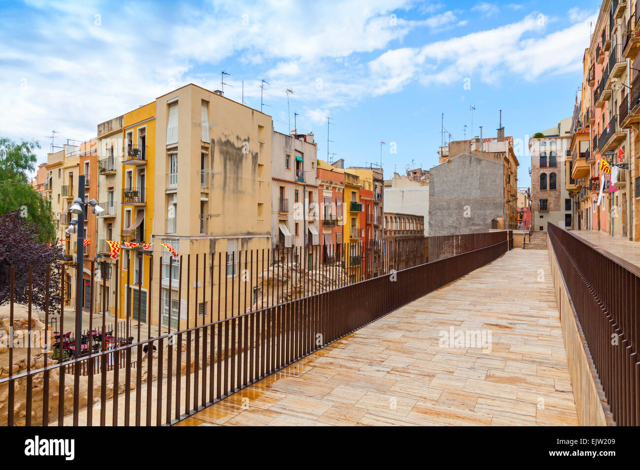Colorful houses facades near pedestrian walking lane, street view of Tarragona, Spain - Stock Image