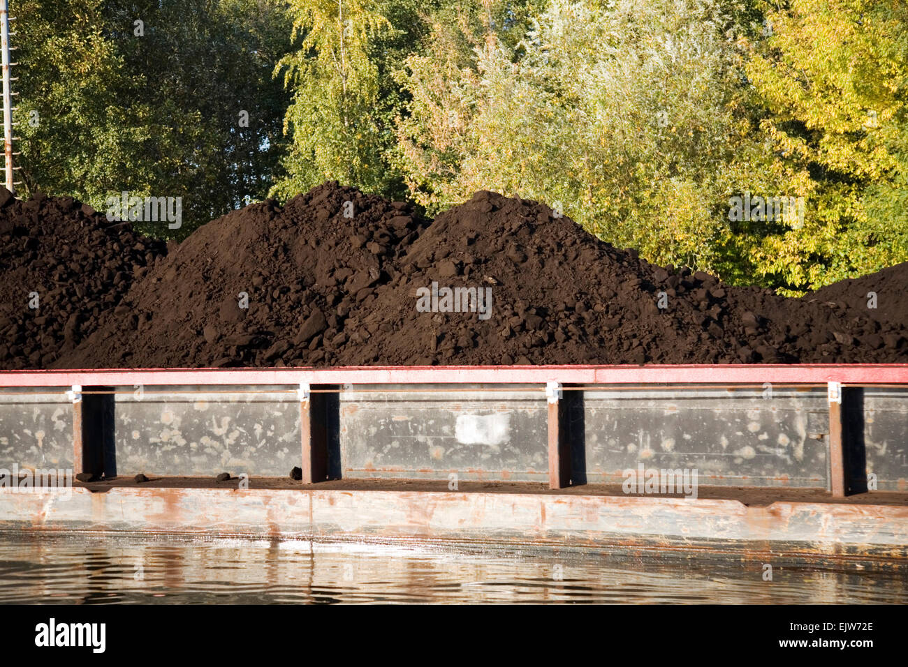 Brown coal loaded on an barge in Germany Stock Photo