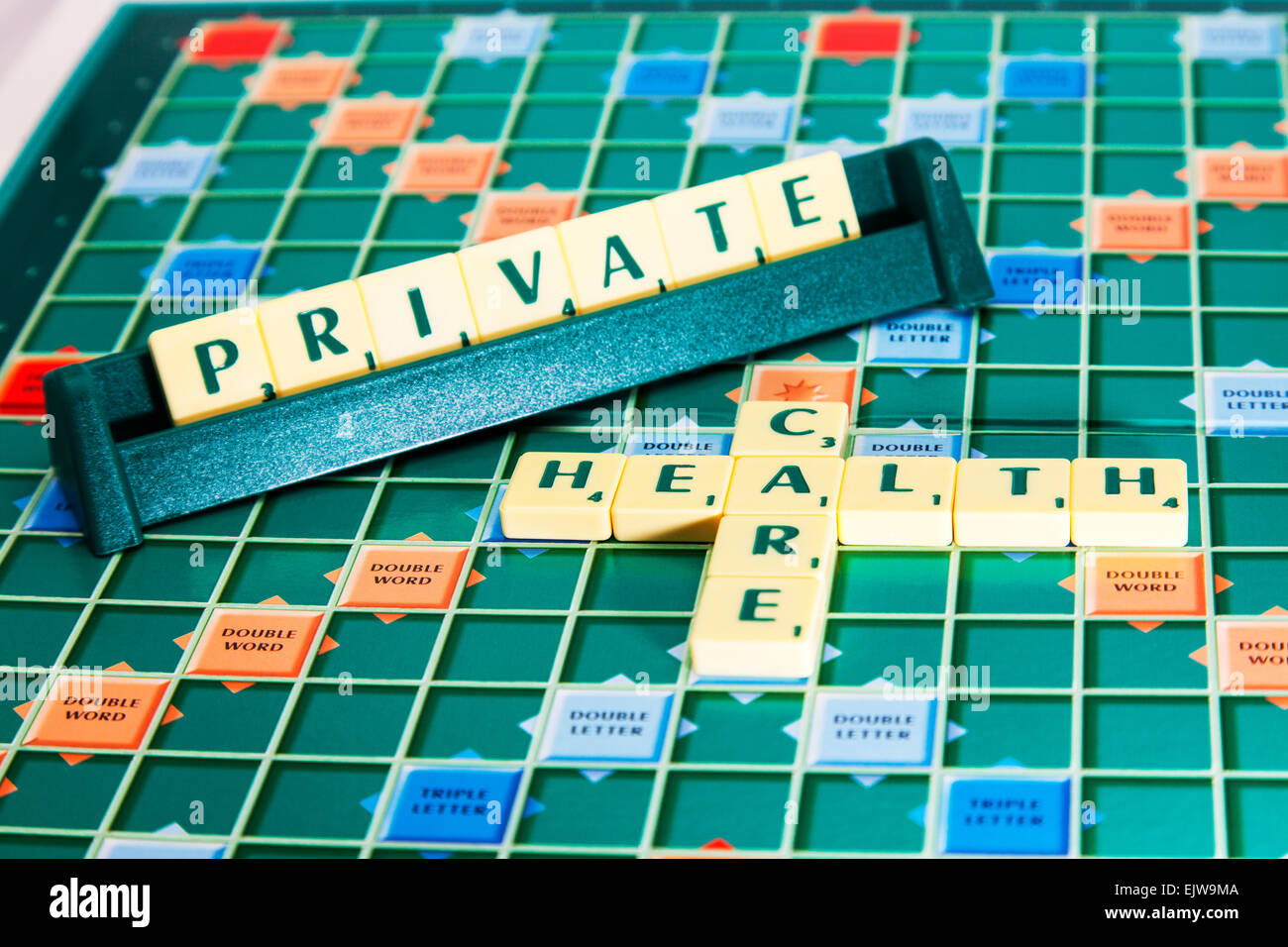 Private health care medical bmi bupa insurance words using scrabble tiles to spell out - Stock Image