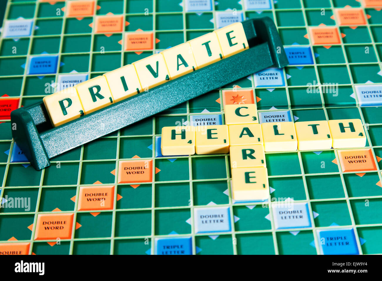 private health care medical bmi bupa insurance words using scrabble tiles to spell out stock