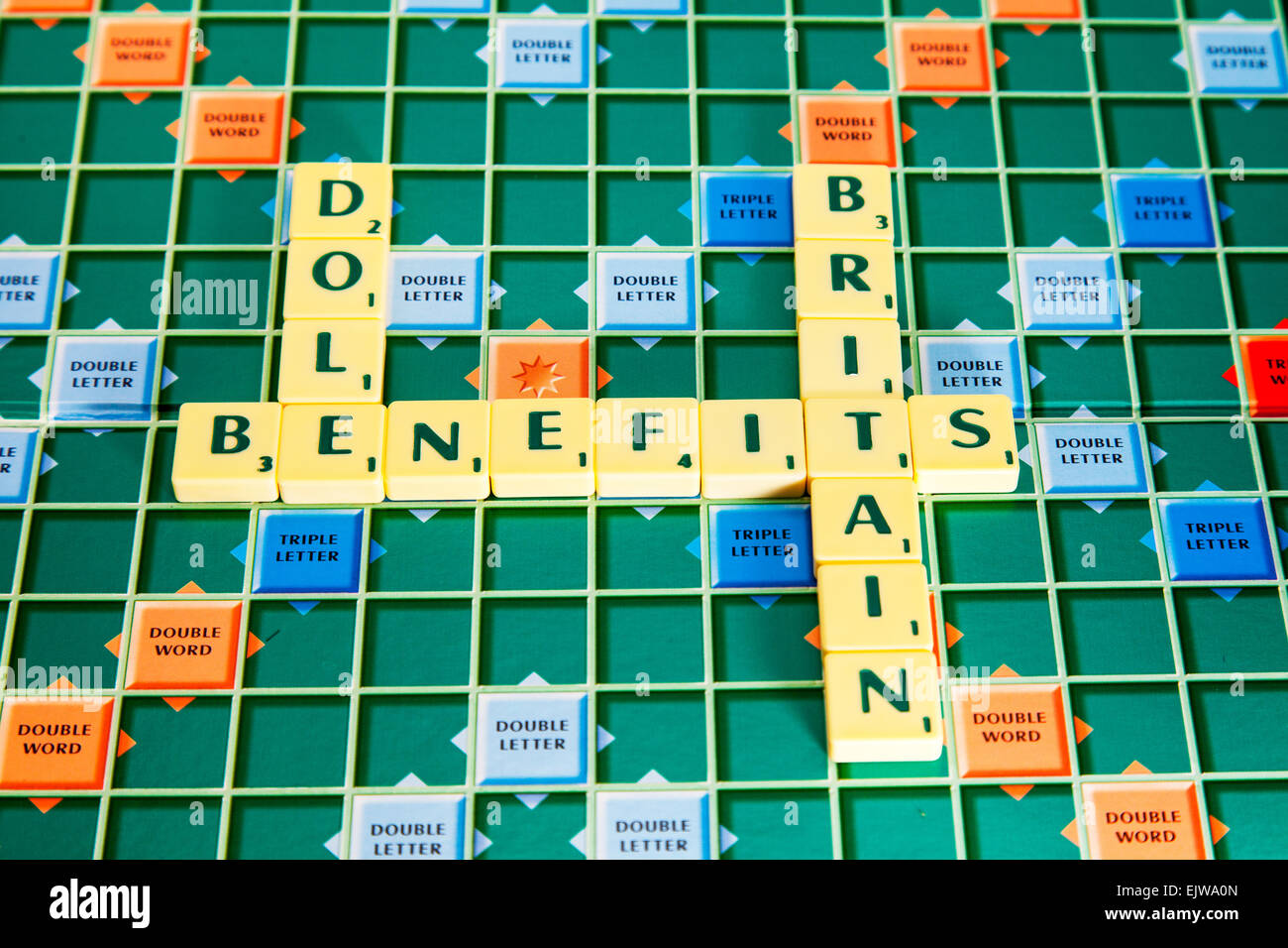 Benefits Britain dole fraud cheats fraudsters work shy spongers words using scrabble tiles to spell out - Stock Image