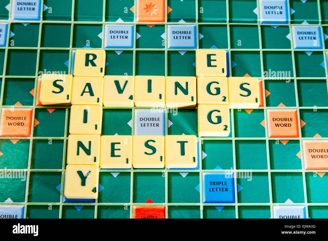 nest egg savings rainy day future pension money save cash words using scrabble tiles to spell out - Stock Image