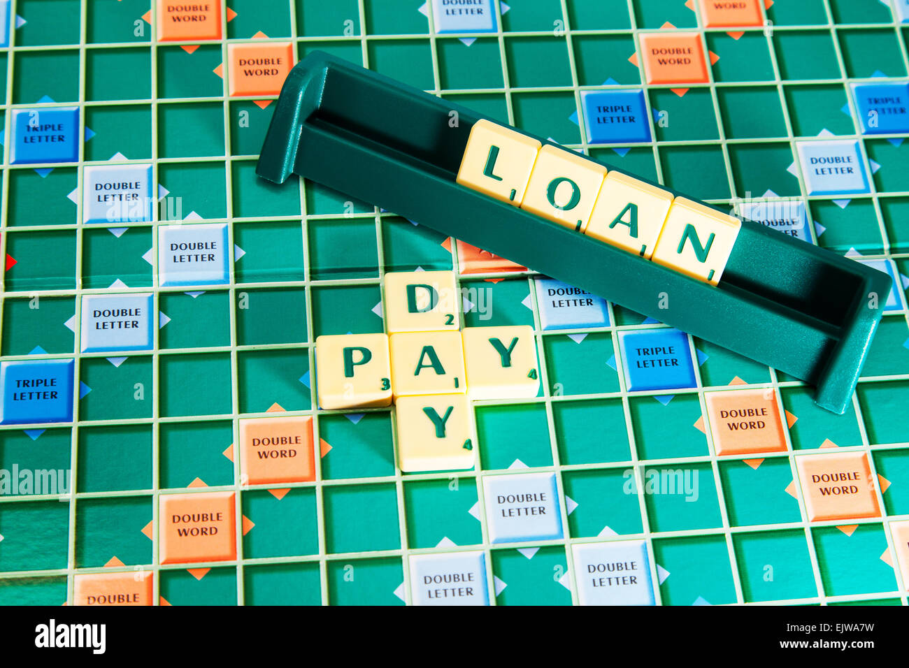 pay day loan loans lending lenders wonga money cash words using scrabble tiles to illustrate spelling spell out Stock Photo