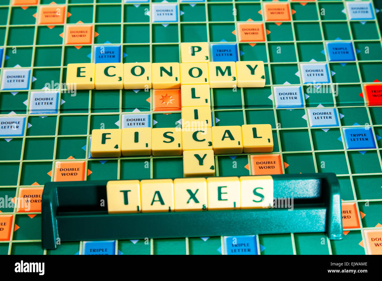 fiscal policy economy taxes studies government raising money tax vat words using scrabble tiles to spell out - Stock Image