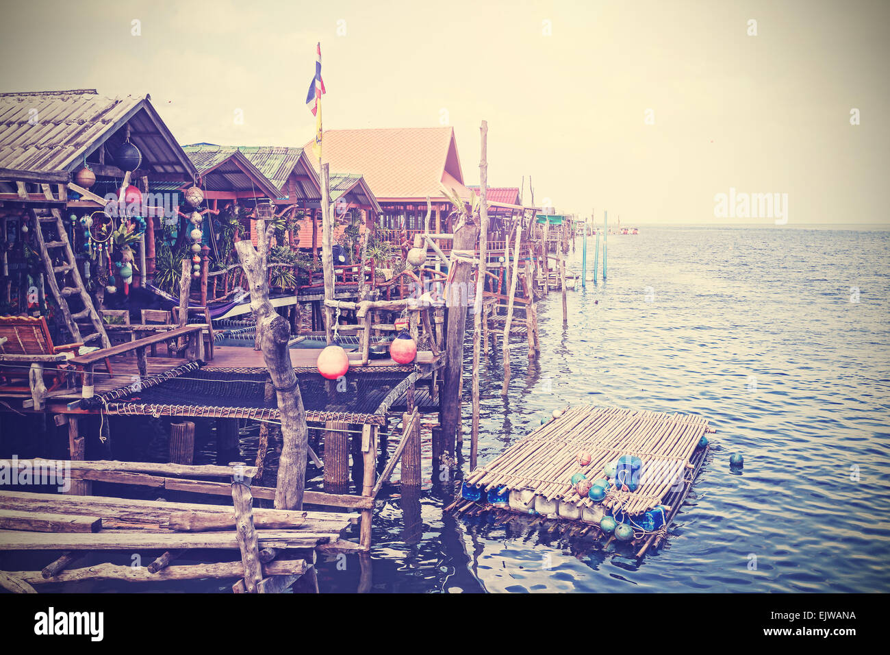 Retro stylized houses on water, settlement on Lanta Island, Thailand. - Stock Image