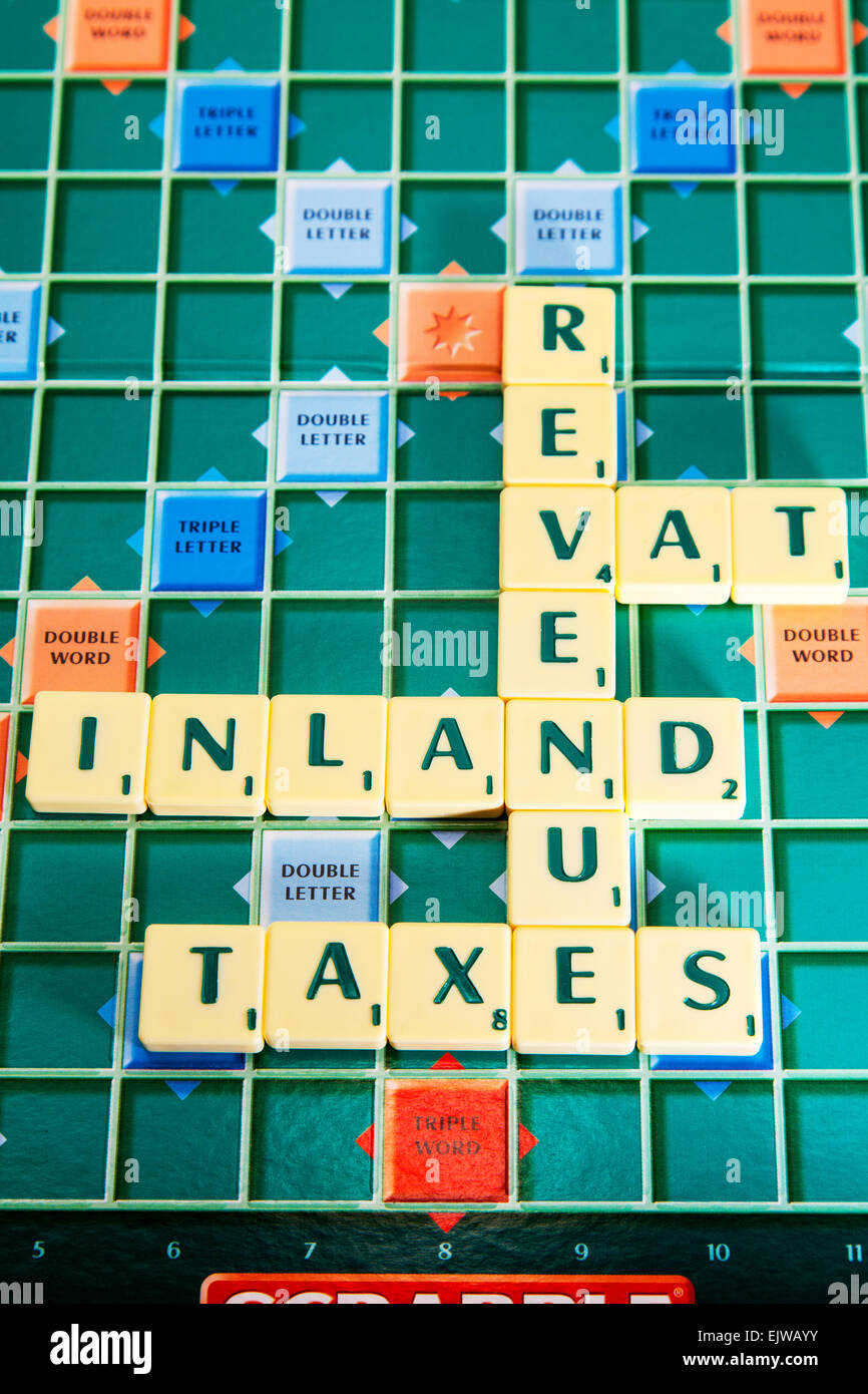 inland revenue vat taxes tax HMRC collection words using scrabble tiles to spell out - Stock Image