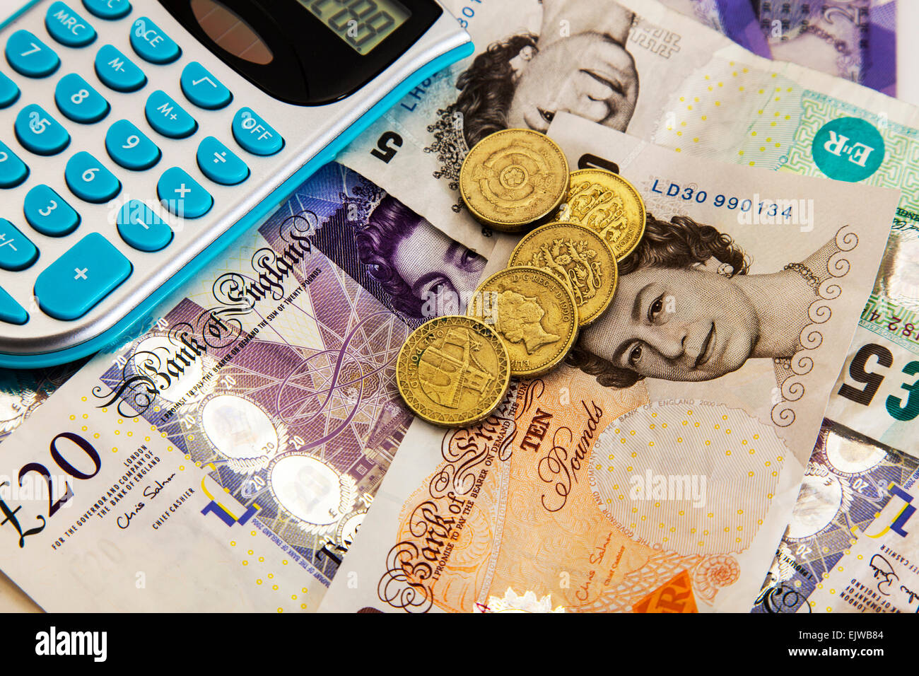 calculator money uk banknotes cash funds money debt bankrupt bankruptcy isolated cutout cut out white background - Stock Image
