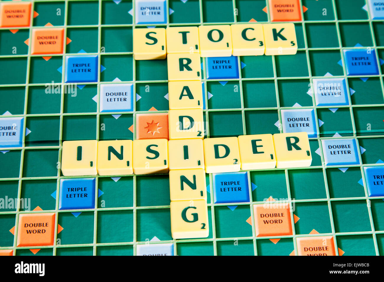 insider trading stocks shares stock exchange deal deals dealers illegal words using scrabble tiles to spell out - Stock Image