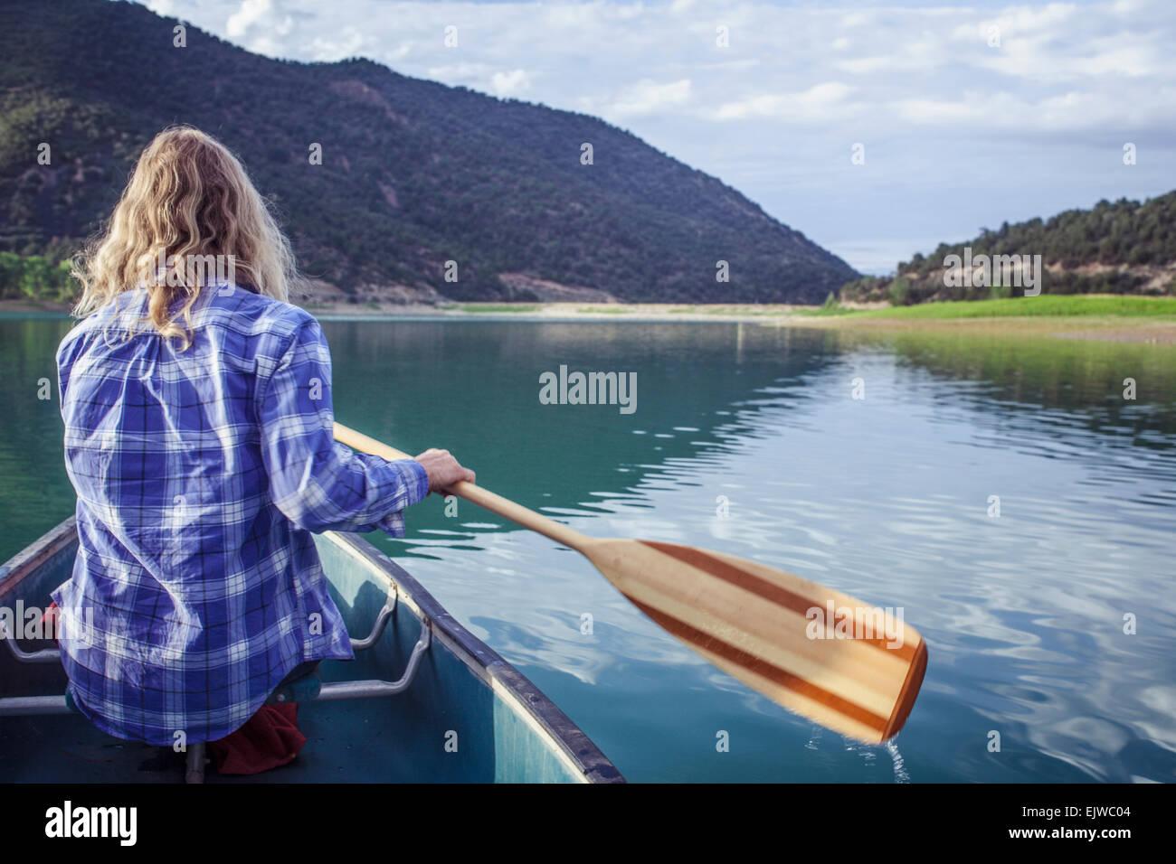 USA, Colorado, Harvey Gap, Woman canoeing in lake - Stock Image