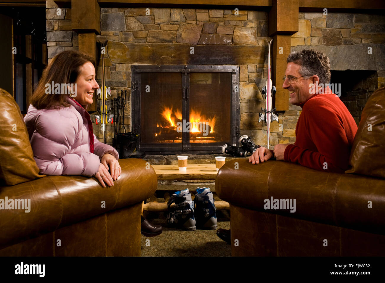 Usa montana whitefish man and woman chatting in front of usa montana whitefish man and woman chatting in front of fireplace teraionfo