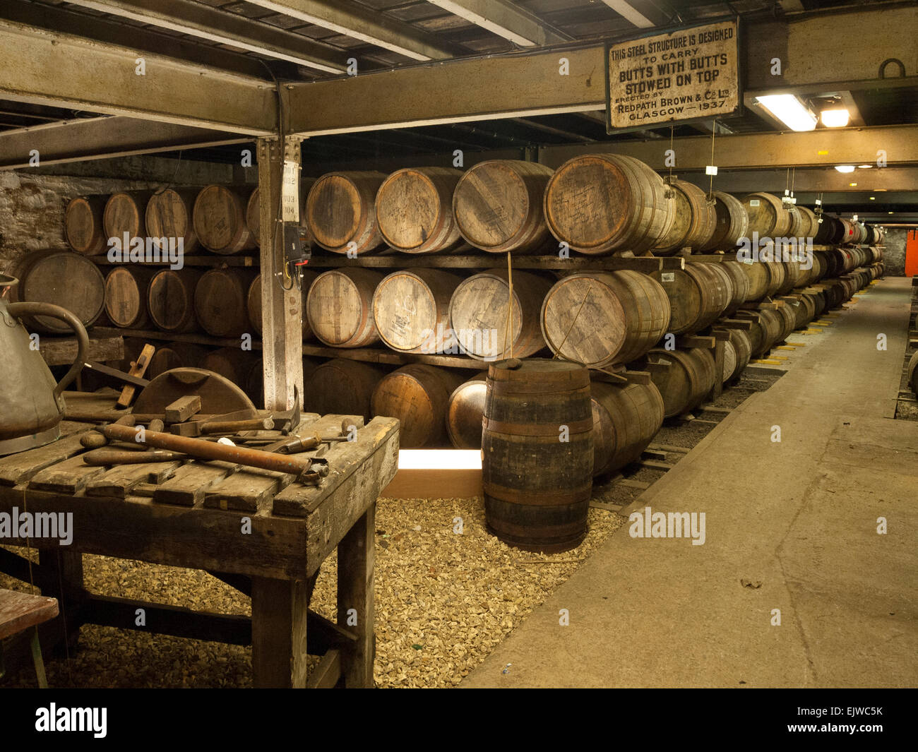 whisky casks in warehouse laphroaig distillery - Stock Image