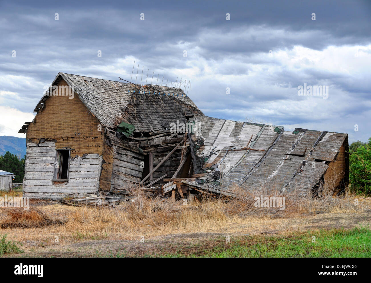 Collapsed Farm Home in Cache Valley Community - Utah - Stock Image