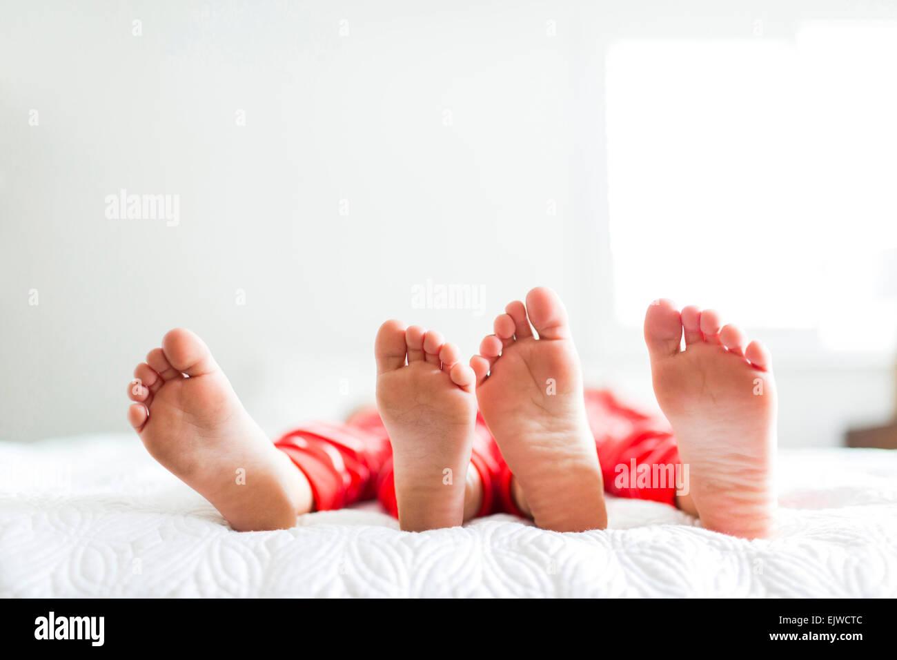 Siblings (2-3, 4-5) in red pajamas - Stock Image
