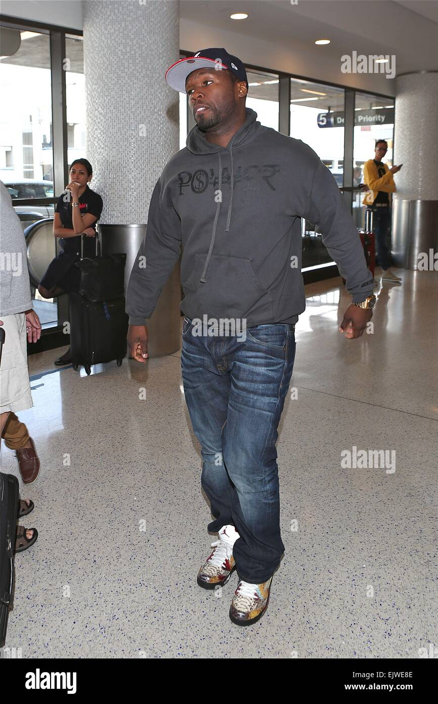 50 Cent takes a fighting stance as he departs from Los