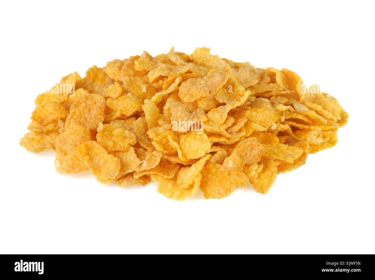 Pile of corn flakes on a white background - Stock Image