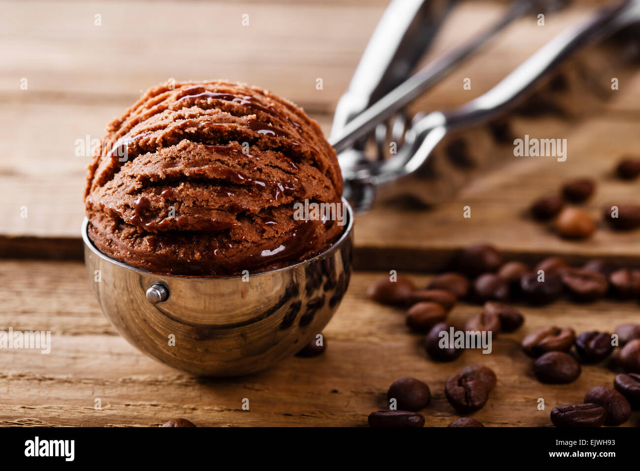 Chocolate coffee ice cream ball scoop spoon - Stock Image