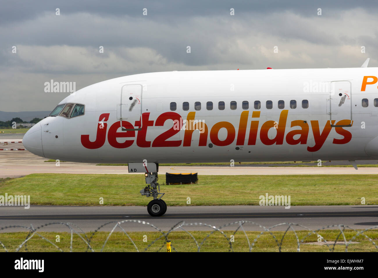 Jet2holidays branded aircraft taxiing towards the terminal at Manchester airport shortly after landing. - Stock Image