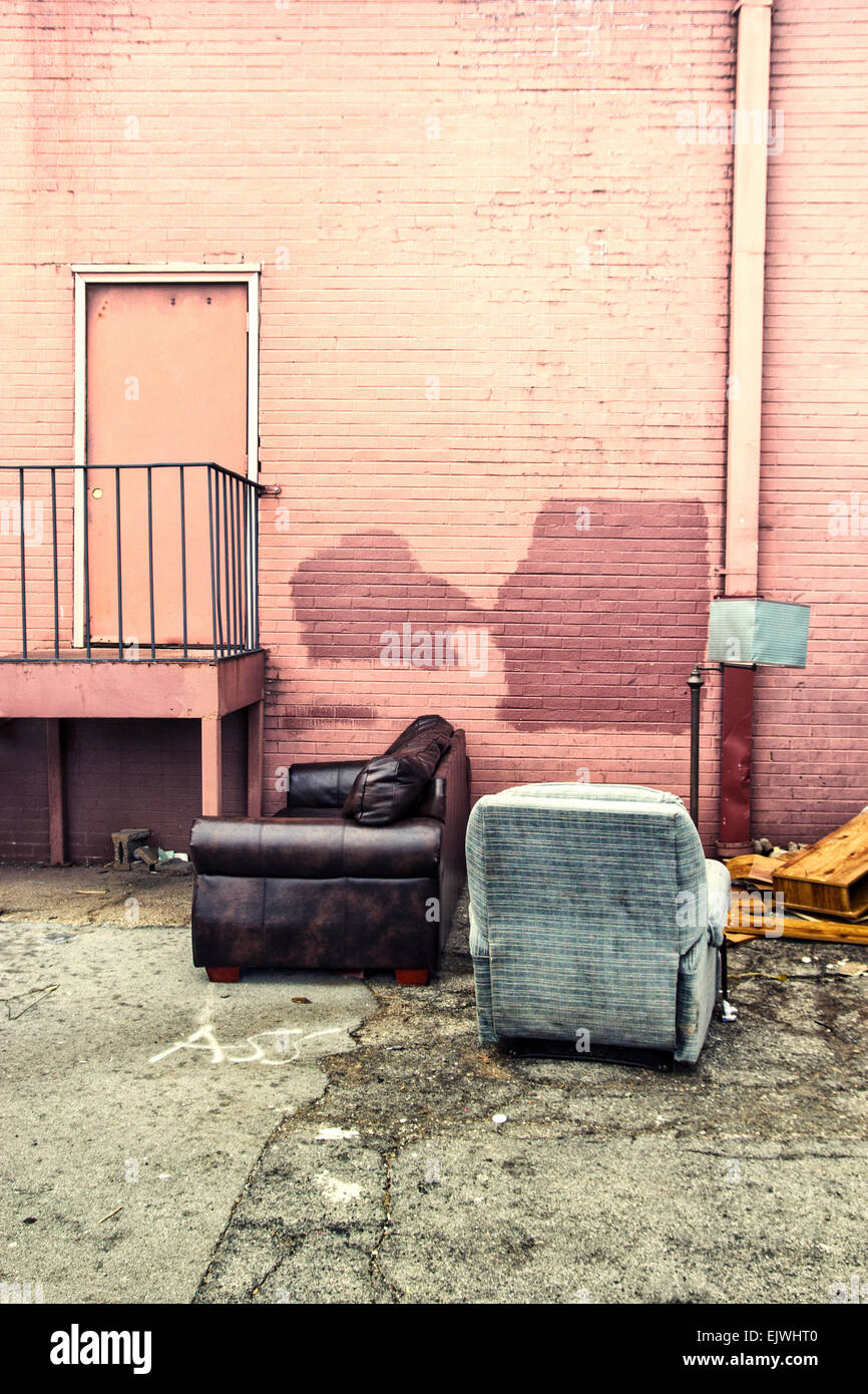 Some abandoned chairs found behind a Good Will store. - Stock Image