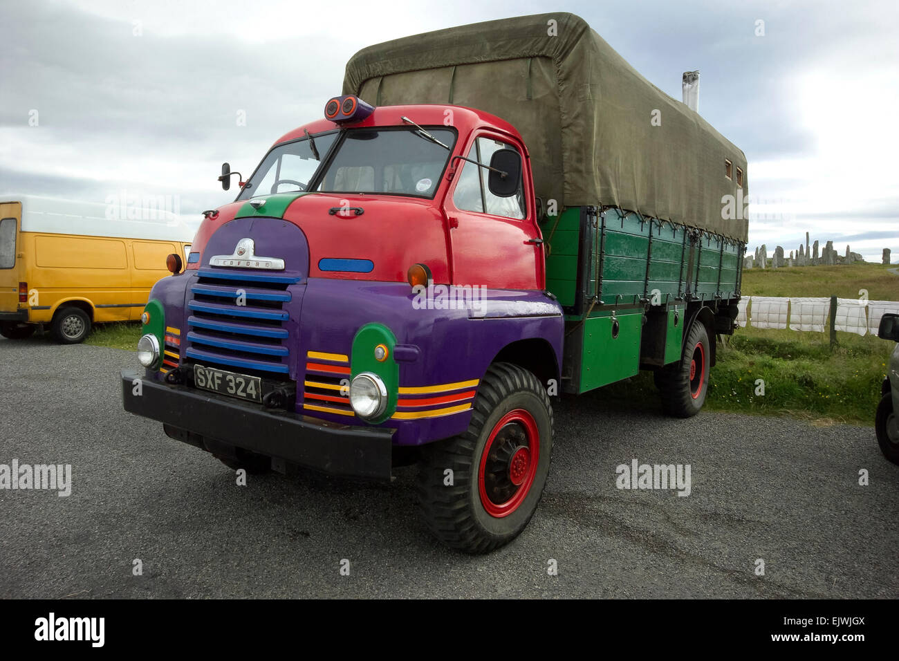 hippy truck bedford conversion brightly cloured painted by callanish stones - Stock Image