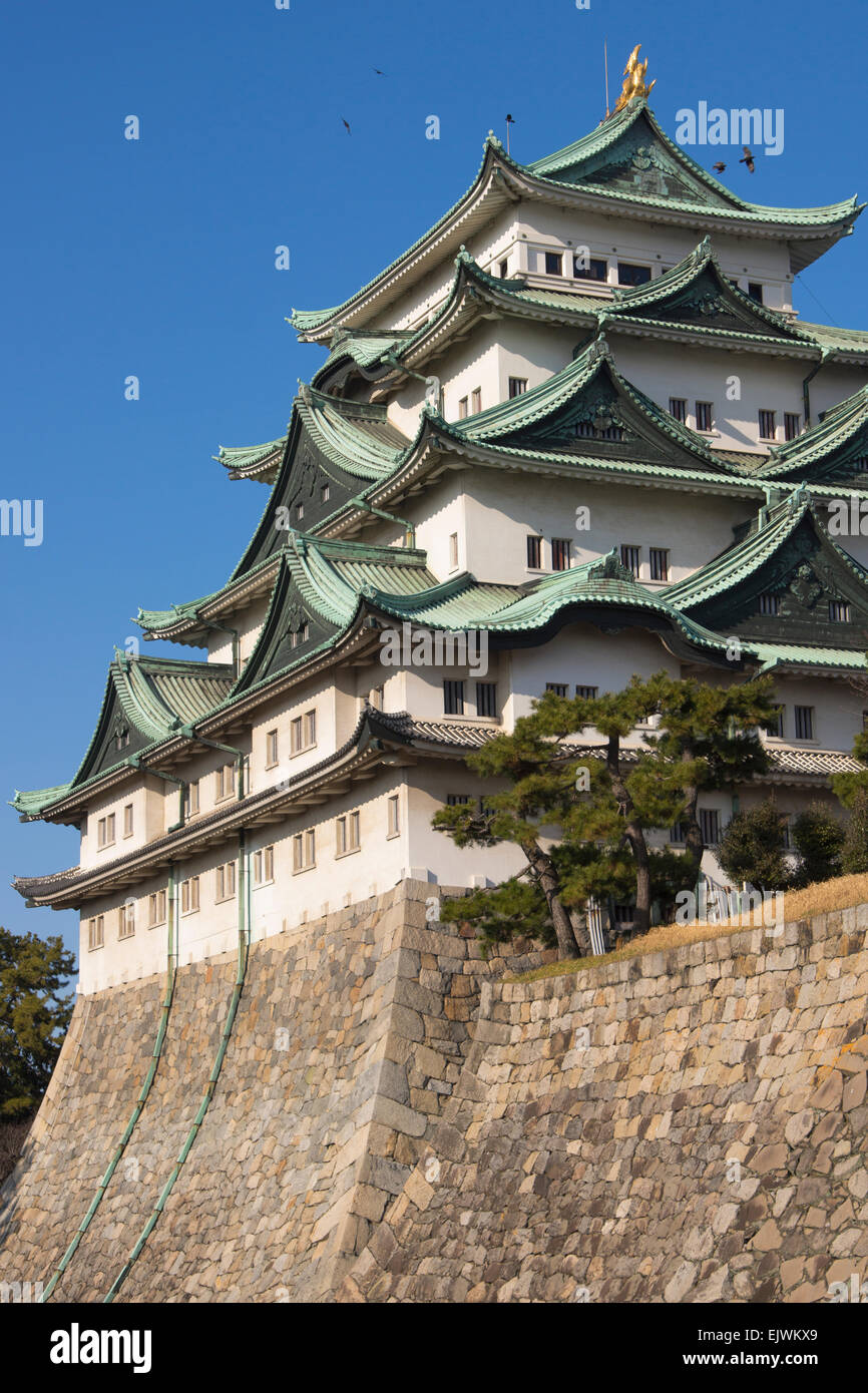 Nagoya Castle on a sunny day with crows circling near the top. Stock Photo