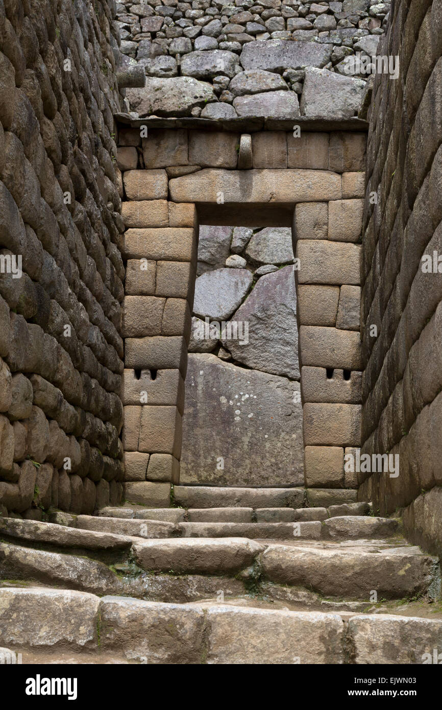 Peru, Machu Picchu.  Trapezoidal Doorway, Ring at Top, Holes on Either Side for Bracing Wooden Door in Place to - Stock Image