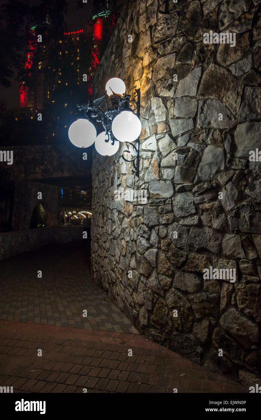 outdoor light fixture stone wall - Stock Image