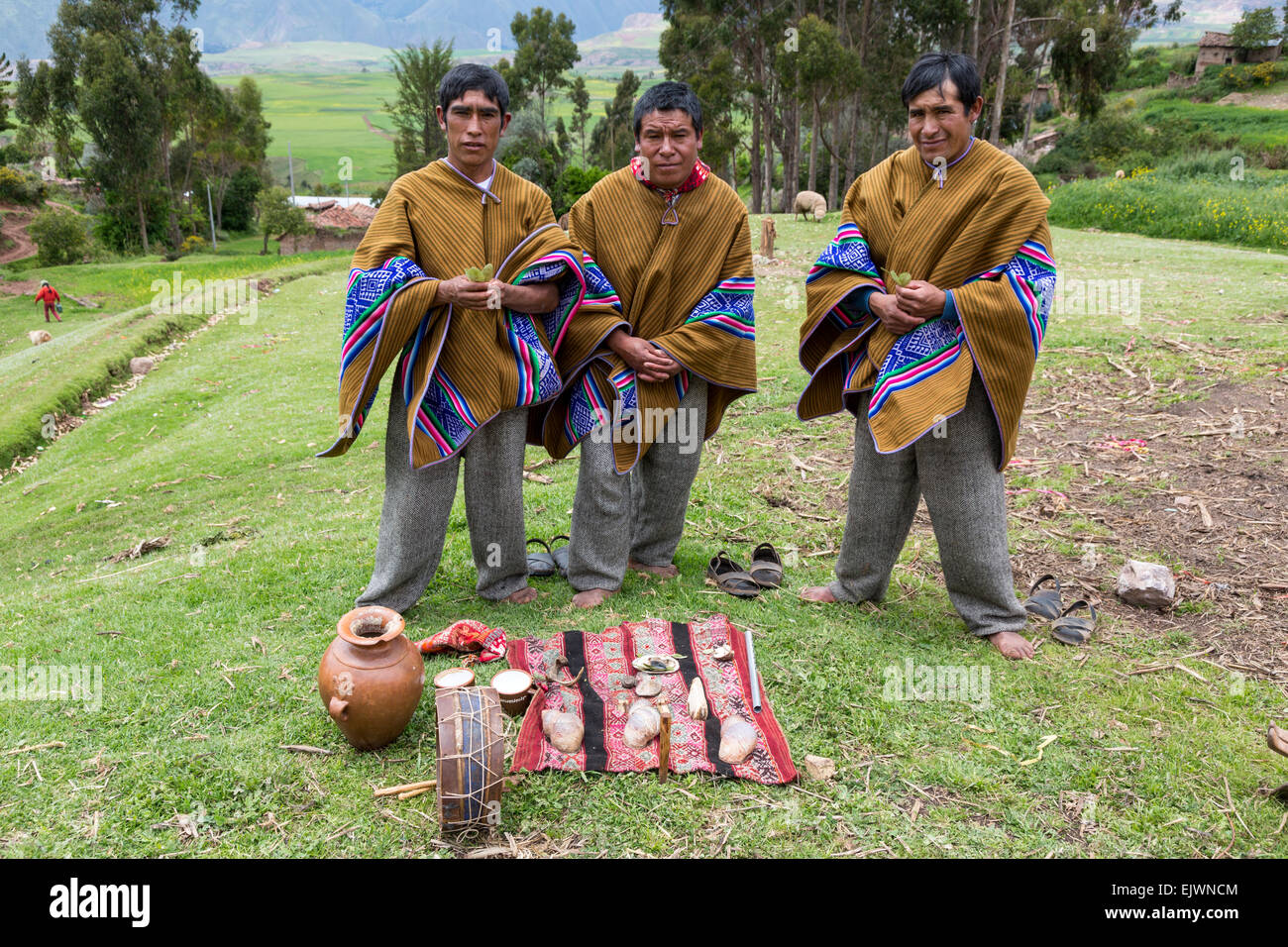 Peru, Urubamba Valley, Quechua Village of Misminay.  Village Men Performing a Welcoming Ceremony for Guests. - Stock Image